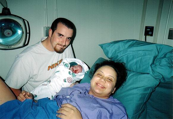 A happy Mom and Dad with a new baby boy.